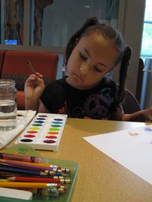 Girl painting with watercolor